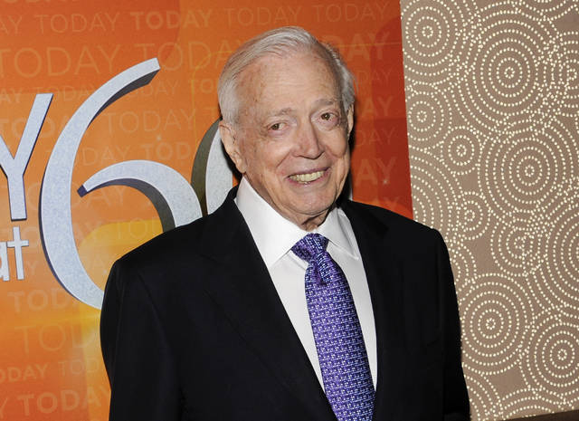 "FILE - This Jan. 12, 2012 file photo shows Hugh Downs at the ""Today"" show 60th anniversary celebration in New York. Downs, a genial and near-constant presence on television from the 1950s through the 1990s, has died. His family said Downs died of natural causes Wednesday, July 1, 2020, in Scottsdale, Ariz. He was 99. Downs was a host of the 'Today' show on NBC, worked on the 'Tonight' show when Jack Paar was in charge, and hosted the long-running game show ""Concentration.""  (AP Photo/Evan Agostini, File)"