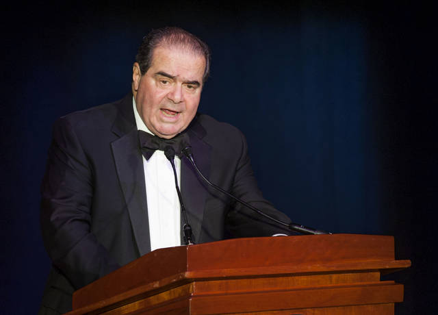 "FILE - In this Nov. 6, 2014, file photo Supreme Court Justice Antonin Scalia speaks in Washington. President Donald Trump has visions of establishing by the final months of his second term—should he win one—a ""National Garden of American Heroes"" that will pay tribute to some of the prominent figures in the nation's history, including Justice Scalia, that he sees as the ""greatest Americans to ever live."" The president unveiled his plan Friday, July 3, 2020, during his speech at Mount Rushmore National Memorial, S.D. (AP Photo/Kevin Wolf, File)"