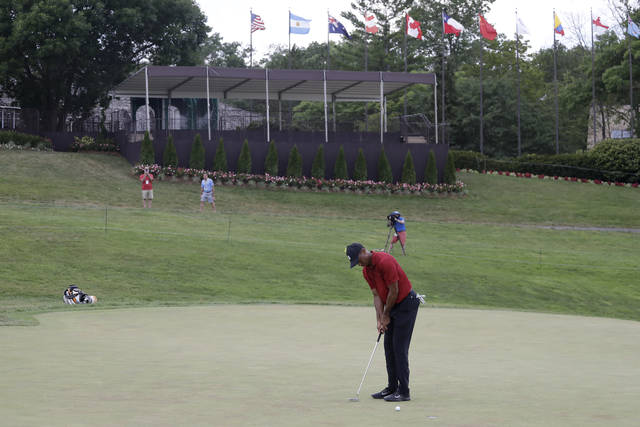 Tiger Woods putts on the 18th green during the final round of the Memorial golf tournament, Sunday, July 19, 2020, in Dublin, Ohio. (AP Photo/Darron Cummings)