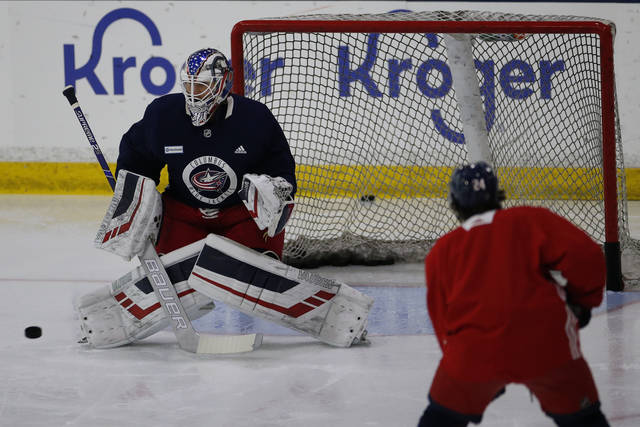 Columbus Blue Jackets' Joonas Korpisalo, of Finland, runs a drill during the NHL hockey team's practice Monday, July 20, 2020, in Columbus, Ohio. (AP Photo/Jay LaPrete)