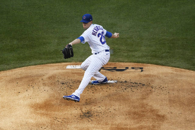 Chicago Cubs starting pitcher Kyle Hendricks (28) throws the ball during the first inning against the Milwaukee Brewers of an opening day baseball game, Friday, July, 24, 2020, in Chicago. (AP Photo/David Banks)