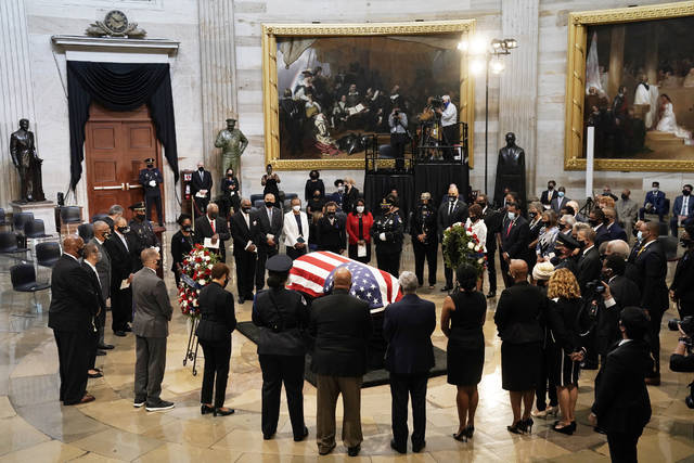 Members of the Congressional Black Caucus, say farewell at the conclusion of a service for the late Rep. John Lewis, D-Ga., a key figure in the civil rights movement and a 17-term congressman from Georgia, as he lies in state at the Capitol in Washington, Monday, July 27, 2020. (AP Photo/J. Scott Applewhite, Pool)