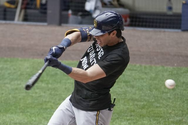 Milwaukee Brewers' Christian Yelich strikes out during an intrasquad game Tuesday, July 21, 2020, at Miller Park in Milwaukee. (AP Photo/Morry Gash)