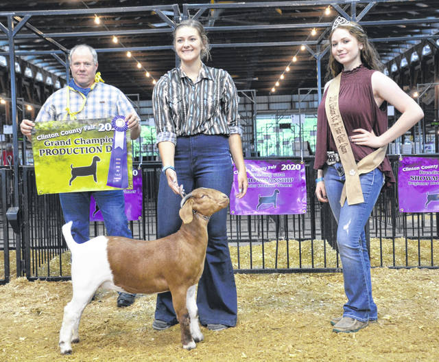Grand Champion Meat Production Doe winner is Cadin Reveal, shown with Judge Joel Smith and Makayla Thomason, Goat Queen.
