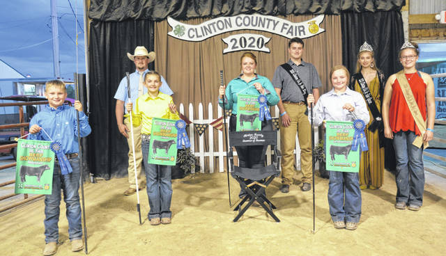 The 2020 Junior Fair's Beef Showmanship winners were honored. From left are: Beginner Winner, Carson Barton; Junior Winner, Hayden Shumaker; Judge Chase Gostomsky; Senior Winner & Showman of Showmen Ashleigh Osborne; Jr. Fair King Ethan Rinehart; Intermediate Winner Taylor Barton; Jr. Fair Queen Annell Prochnow; and Beef Queen Haley Dean.