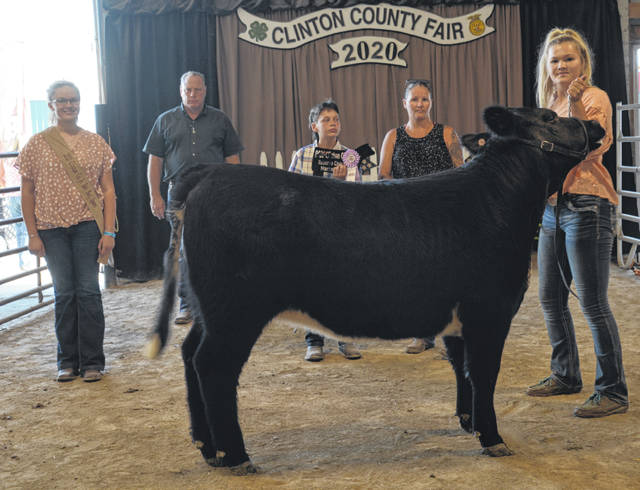 Reserve Champion Market Heifer winner was Caitlyn Lakes, shown with Beef Queen Haley Dean, Judge Rick Davis, Elliot Pell and Angie Lakes.