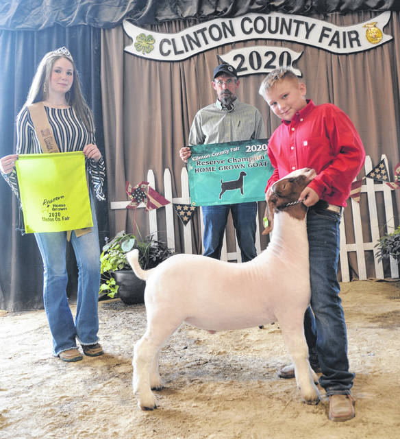 Reserve Champion Home Grown Market Goat winner is Carson Barton, shown with Goat Queen Makayla Thomason and Judge Jeff Jester.