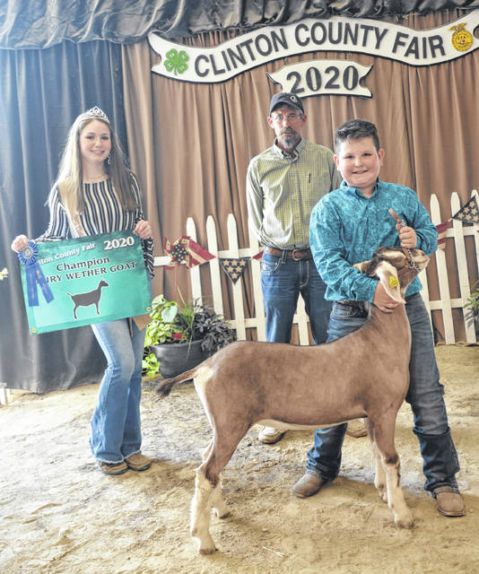 In the 2020 Clinton County Jr. Fair's Goat Show Champion Dairy Wether winner was Cooper Dillion, shown with Goat Queen Makayla Thomason and Judge Jeff Jester.
