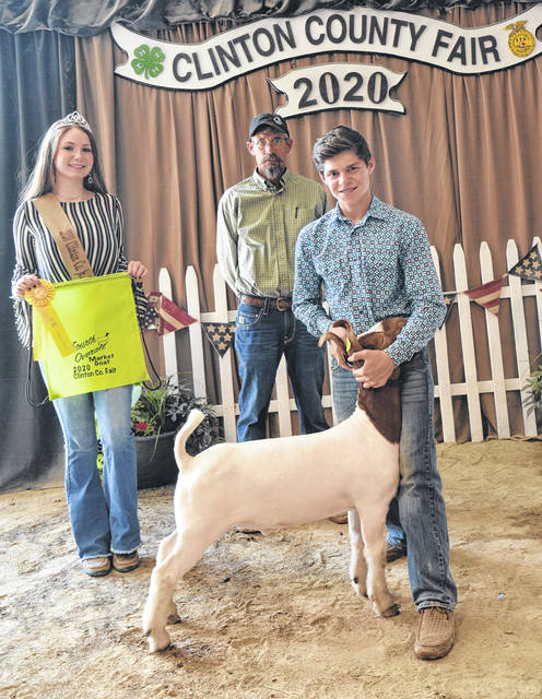 Reserve Champion Market Goat winner was Jaden Snyder, shown with Goat Queen Makayla Thomason and Judge Jeff Jester.