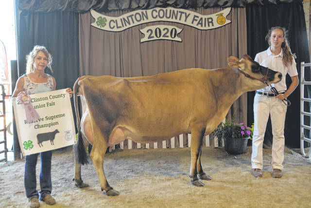 Reserve Champion Supreme Dairy Cow winner was Caili Bauman, with Judge Sherry Smith.