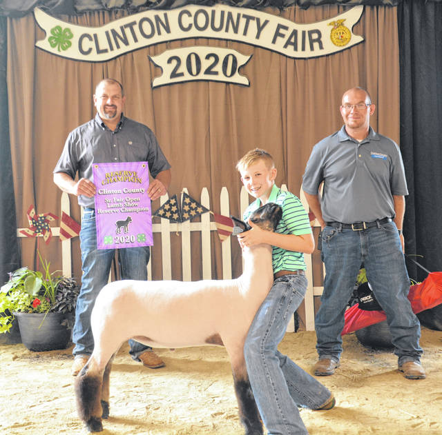Reserve Champion Carson Nahrup is with Judge Matt Martin and Sr. Fair Board member Jason Vance.