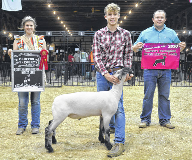 Reserve Champion Home Grown Market Lamb was won by Juston Arnold, shown with Lamb & Fleece Queen Shaleigh Duncan and Judge Andrew Sloan.