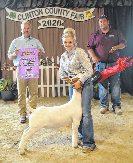 Reserve Champion Kylie Price is flanked by Judge Doug Bayless and Sr. Fair Board member Scooter Milner.