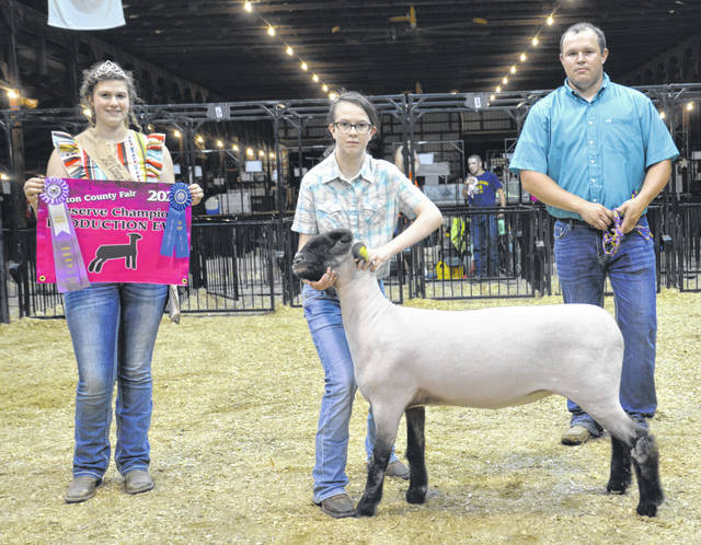 Reserve Champion Production Ewe winner was Alyssa Hutchinson, shown with Lamb & Fleece Queen Shaleigh Duncan and Judge Andrew Sloan.