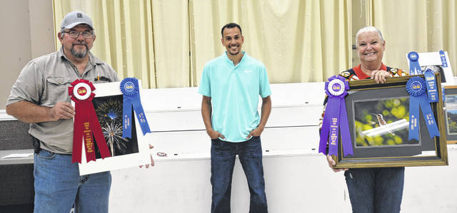 In Open Photography at the 2020 Clinton County Fair — with over 400 entries and 50 exhibitors, winners included, from left, Reserve Champion Dave Shaw (Photo from Color Print); Judge Gordon Cordell; and Grand Champion Jackie Schneder (From Framed).