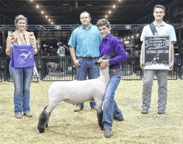 Fourth Overall Market Lamb was won by Devon Snyder, shown with Lamb & Fleece Queen Shaleigh Duncan, Judge Andrew Sloan and Jr. Fair King Ethan Rinehart.