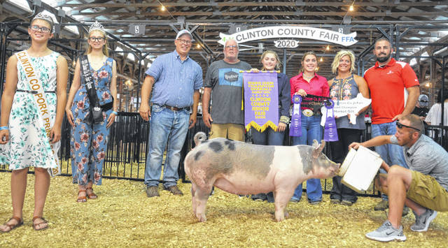 Reserve Champion Overall was won by Jessie Stewart, shown with family members as well as Pork Princess McKinzey DeBord, Fair Queen Annell Prochnow and Judge Kevin Wendt.