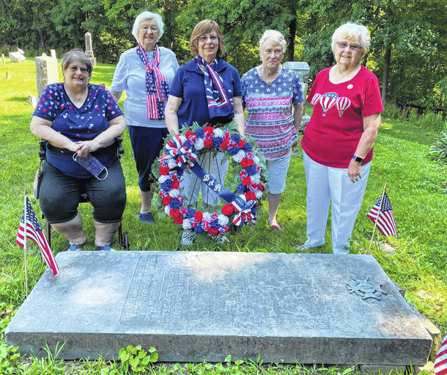 Susan Henry, center, a descendant of Abraham Ellis and a George Clinton Chapter, NSDAR member, honored Revolutionary War soldier Abraham Ellis by placing a wreath at his grave side. Also pictured are George Clinton Chapter members Leslie Holmes, Joyce Peters, Nancy Bernard and Frances Sharp.