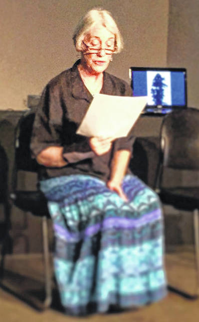 A volunteer reader shares the testimonial of an atomic bombing survivor during the vigil held in 2015.