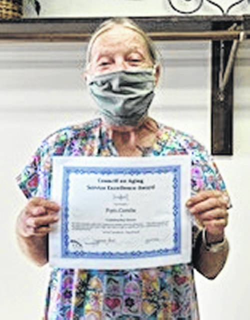 "Pam Combs, who works as a homemaker for the Clinton County Community Action Homemaking Program, was recently recognized by the Council on Aging after receiving accolades from one of her senior clients. The client stated that Pam does a good job, she always goes out of her way to help, and the client doesn't have to tell her anything. He stated that she does a ""whale of a job."" The Homemaking program provides services for seniors enabling them to remain self sufficient in their homes."