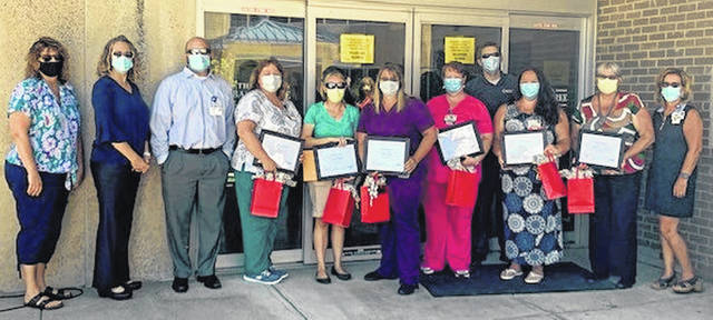 From left are Terri LeMasters, Director of Pharmacy and Respiratory; Lesley Wininger, CNO; Eric Jost, CFO; award finalists Stacey Daniel and Leslie Moke; award winner Lanna Fair; award finalist Luann Mellinger; Lance Beus, CEO; award finalists Mandy Prater and Gretchen James; and Teresa Daniels, Director of HR.