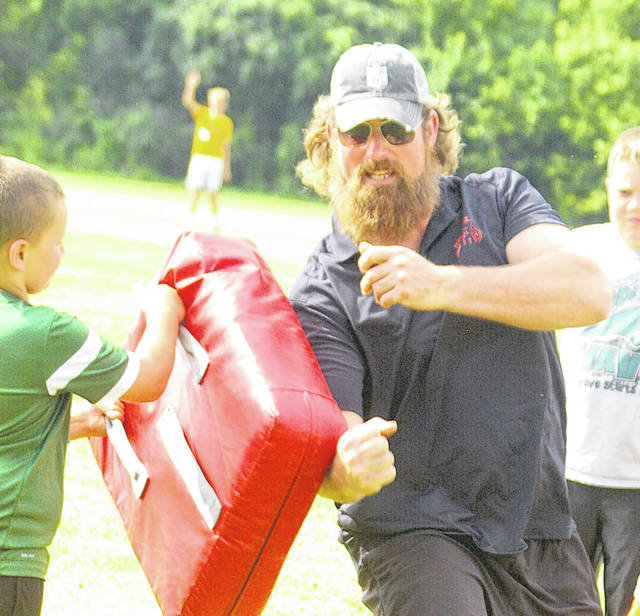 Matt Light, shown here at his youth football camp in Greenville, Ohio, is the No. 4 offensive lineman on the list.