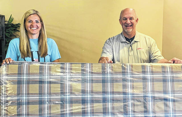 From left are Carrie Zeigler, SHP Co-President, and Andy Holmes, Rent-2-Own General Manager.