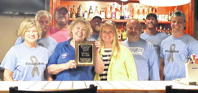 Friends of Brian Mudd — from left are Nancy Rudduck, Ron Rudduck, Justin Young and Connie Wilson of MacD's, Jimmy Brady, Tammy Mudd, Travis Miller, Dustin Eads and Kyle Rudduck. Not pictured is Margie Eads.