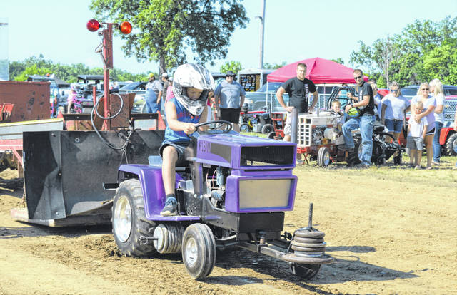 Participating in the graden tractor pull appeals to some of the younger generation.