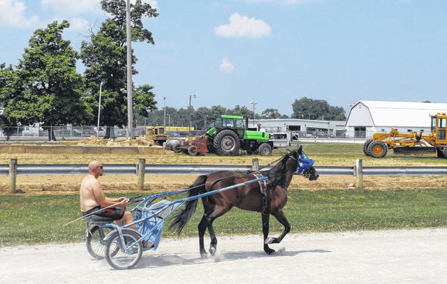 It was hot and humid Monday, but there were several people and horses doing a harness racing workout on the track at the Clinton County Fairgrounds. There will be harness racing events starting 5 p.m. on both Monday, July 13 and Tuesday, July 14 during fair week.