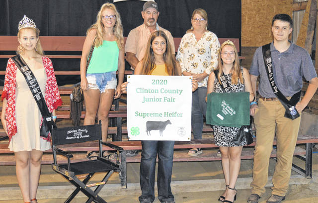 The Supreme Champion Dairy Heifer exhibited by Maggie Mathews (front row second from left) of the New Vienna area raised a $2,475 premium. The buyers are American Equipment Service, Bush Auto Place, Clinton County Board of Realtors, LT Land Development, New Horizon Farm & Dairy, Prengers Inc., Rob's Equipment, Sherwood Auto and Camper Sales, Sunrise Cooperative, KC Farms, Ohio Dairy Magazine, and the Caesar Creek Market.