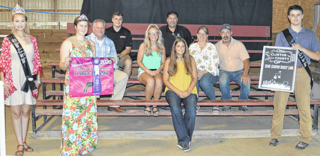The grand champion market lamb exhibited by Maggie Mathews (sitting in the center foreground) of the New Vienna area raised a $2,500 premium at the Clinton County Junior Fair Sale of Champions. The buyers are ATSG (Air Transport Services Group), Alexander Show Feeds, Arehart-Brown Furneral Services LLC, Autumn Years Nursing Cente, Bush Auto Place, First State Bank, LT Land Development, Lowes, New Horizon Farm & Dairy, M & K Show Stock, Sherwood Auto and Camper Sales, Tro Go Amish Recipe Pretzels and Doughnuts, Wilmington Auto Center - Chrysler, Dodge, Jeep, Greater Tomorrow Health, Fayetteville Hardware, Ohio Dairy Magazine, Emma Mathews Photography, Caesar Creek Market, and Zurface Farms.