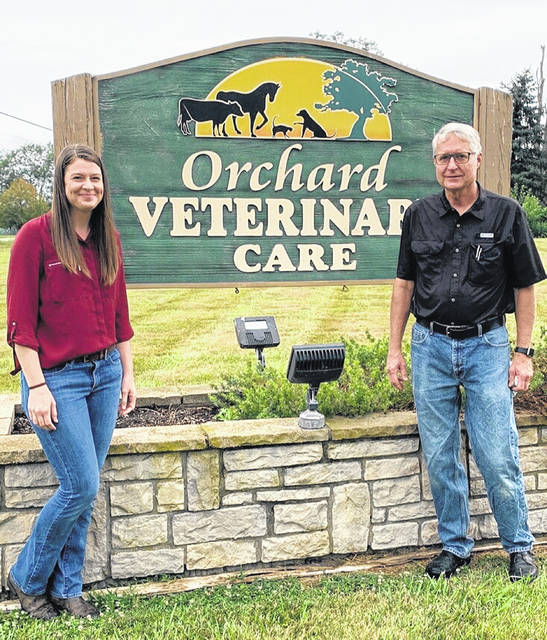 Orchard Veterinary Care owner Dr. Allison Bittner with former longtime owner Dr. Robert Gano, who will continue there as a practicing veterinarian.