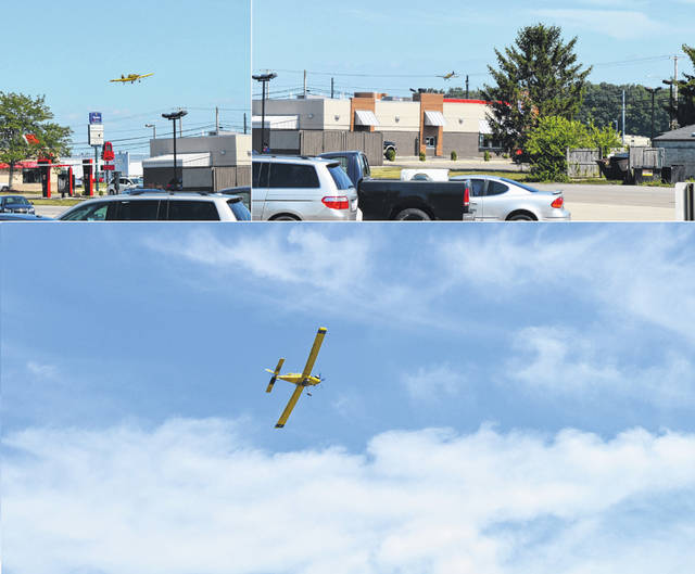 """A low-flying crop duster has been in Clinton County this week. Its appearances annually prompt a lot of curiosity as calls to local law enforcement — especially when the plane is flying low along the Rombach Ave. strip and over the nearby crops, as well as appearing to be """"dusting"""" Burger King and other businesses along the route, as this composite photo shows."""