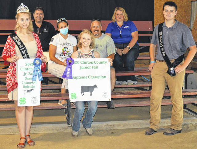 The Supreme Champion Cow exhibited by Emily Quallen (center foreground) of the Wilmington area raised a $1,900 premium. The buyers are AIA Designer Set and Mike and Annette Houck, ATSG (Air Transport Services Group), American Equipment Service, BDK Feed & Supply, Bush Auto Place, Cherrybend Pheasant Farm / Ellis Farms, Croghan Trucking / Tom Rayburn Memorial, Groves Tire & Service, Orchard Veterinary Care LLC, Peoples Bank, Prengers Inc., David Quallen /Pioneer Seed, Greg and JoAnn Quallen, Rob's Equipment, Schneder Farms, Seaman Construction, Smith Farms Trucking, Wilmington Auto Center - Chrysler, Dodge, Jeep, the Wilmington Savings Bank, Mary Beth and Terence Habermehl, Tracie Montague, Quallen's Lawn & Landscape, Bottom Line Farm, KC Farms, and James Hackney.