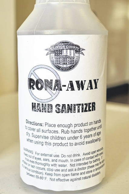 Next to a door at the County Annex Building, a bottle of hand sanitizer wants us to stamp out Rona — a popular abbreviation for the coronavirus.