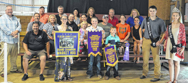 The 2020 Grand Champion Market Hog exhibited by Wade Smith (the boy in the center foreground holding the larger banner) of the New Vienna area raised a $3,730 premium. The buyers are AG & EX Construction, AIA Designer Set and Mike and Annette Houck, ATSG (Air Transport Services Group), Accurate Soils, Agrigold Hybrids, American Equipment Service, Andy Kenney Excavating, Arehart-Brown Funeral Services LLC, Caesar Creek Animal Clinic - Dr. Matt Carey, Caribou Sanitation, Cherrybend Pheasant Farm / Ellis Farms, ClintHigh Club Pigs, DeBold Builders, Earl Schneder Equine Dentistry, Fedcrop Insurance, Fox Towing & Truck Service, Groves Tire & Service, Healthsource of Ohio, Ag-Pro, Susanne Kenney, Kwest Communications, Longs Pharmacy, Lowe's, Mayer Farm Equipment, McCarty Gardens, McDonald & Sons Elevator, Steve and Roseanne McKay, Merchants National Bank, Perry and Michele Milner Family, Parks Livestock, Peoples Bank, Janielle Runyon, Sams Meats, Schneder Farms, Sherwood Auto and Camper Sales, Kasey Smith - Auctioneer - Wendt Group, Brady and Donna Snyder, Southern Hills Community Bank, Sunrise Cooperative, Ron Trusty Insurance, Vaughan Livestock, Wilmington Auto Center - Chrysler, Dodge, Jeep, Brad and Angela Woodruff, Greater Tomorrow Health, Kevin, Cathy and Kodey Smith, Auctioneer Harley Jackson, Cameron Vaughan Farms LLC, and Natalie Brunk.