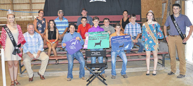 The Reserve Champion Market Goat exhibited by Jaden Snyder (standing behind director's chair) of the Wilmington area drew a $1,900 premium. The buyers are Accurate Soils, American Equipment Service, Arehart-Brown Funeral Services LLC, Autumn Years Nursing Center, Bush Auto Place, Cherrybend Pheasant Farm / Ellis Farms, Chris Collett Trucking LLC, Croghan Trucking / Tom Rayburn Memorial, Nutrien Ag Solutions, D'Shealy Designs, DeBold Builders, Doug Rinehart, Marci and Mitchell Ellis, Groves Tire & Service, Henry and William Hildebrandt, Ag-Pro, Johnson Durocs, Bill Marine Ford, Steve & Roseanne McKay, Merchants National Bank, Smith Funeral Homes, Schneder Farms, Seaman Construction, Sunrise Cooperative, Ron Trusty Insurance, Vital Fitness, Murphy Farms, Murphy Family, Fayetteville Hardware, Houseman Woodworking, Bennett Family, and McDade Show Goats.