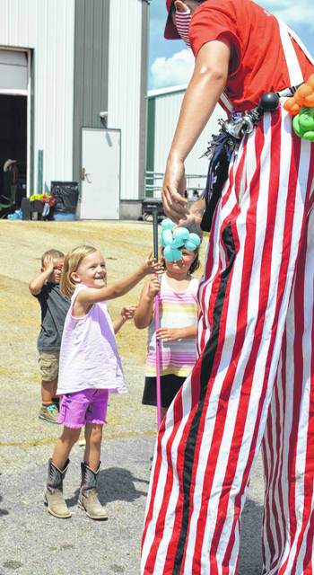 Two balloon artists on stilts were strolling entertainers Saturday at the Clinton County Fair. They would take children's requests and transform a balloon into the shape of an animal. They are scheduled to return to the fair on its final day, Saturday, July 18.