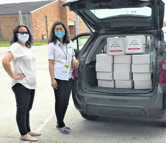 Ruth Brindle of the Clinton County Port Authority and Sangmi Kim of the SBDC with Small Business Safety Toolkits loaded for delivery throughout the county.