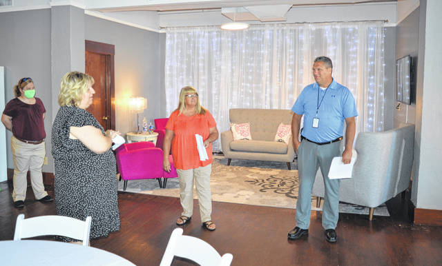 "The Clinton County commissioners on Monday toured the space newly occupied by the Clinton County Convention & Visitors Bureau (CCCVB) above Rome Jewelers in the Samuel Walker Building on Main Street in downtown Wilmington. Clinton County Commissioners President Kerry R. Steed said the new location can be ""a productive space"" with the capacity to rent out space for small gatherings as well as a conference room. From left are CCCVB Board Treasurer Tonya Hunter, Executive Director Susan Valentine-Scott, and Commissioners Brenda Woods and Mike McCarty. Looking ahead, Valentine-Scott said they will be making the loft a downtown event space for smaller wedding receptions, birthday parties, graduation parties, business meetings / luncheons and more."