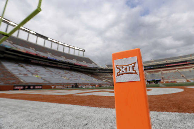 FILE - In this Oct. 7, 2017, file photo, a Big 12 pylon marks the end zone at Darrell K Royal Texas Memorial Stadium before an NCAA college football game between Texas and Kansas State in Austin, Texas. Big 12 schools have agreed to play one nonconference football game this year to go along with their nine league contests as plans for the pandemic-altered season continued to fall into place. (AP Photo/Eric Gay, File)