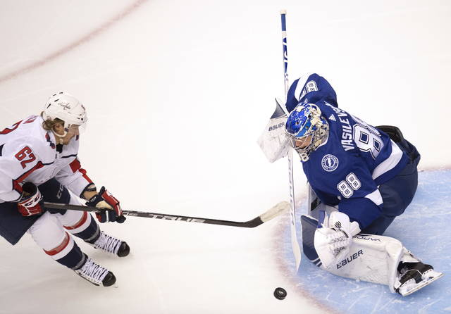 Tampa Bay Lightning goaltender Andrei Vasilevskiy (88) makes a save on Washington Capitals left wing Carl Hagelin (62) during the first period of an NHL hockey playoff game   Monday, Aug. 3, 2020 in Toronto. (Frank Gunn/The Canadian Press via AP)