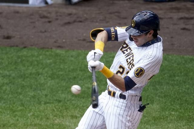 Milwaukee Brewers' Christian Yelich hits an RBI triple during the third inning of a baseball game against the Cincinnati Reds Sunday, Aug. 9, 2020, in Milwaukee. (AP Photo/Morry Gash)