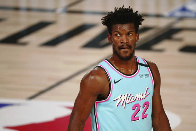 Miami Heat forward Jimmy Butler waits between plays during the first half of the team's NBA basketball game against the Indiana Pacers on Monday, Aug. 10, 2020, in Lake Buena Vista, Fla. (Kim Klement/Pool Photo via AP)