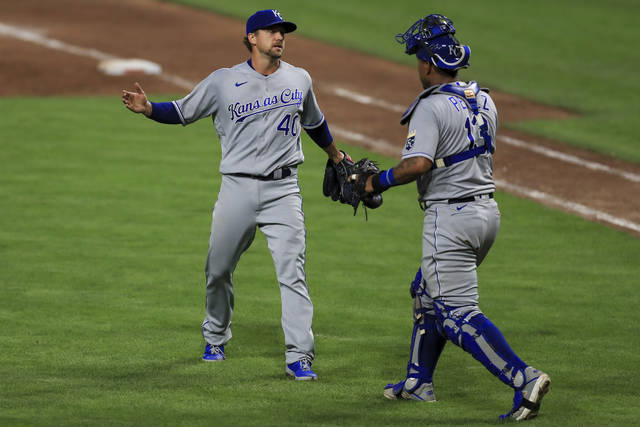Kansas City Royals' Trevor Rosenthal (40) reacts with catcher Salvador Perez (13) after a baseball game against the Cincinnati Reds in Cincinnati, Wednesday, Aug. 12, 2020. The Royals won 5-4. (AP Photo/Aaron Doster)