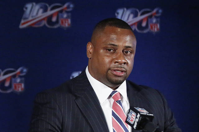 "FILE - In this May 22, 2019, file photo, Troy Vincent, NFL executive vice president, speaks to the media during the owners meetings in Key Biscayne, Fla. The NFL will consult an advisory committee made up of former coaches, general managers and players on such issues as postponing, moving or even canceling games this season due to the coronavirus pandemic. Vincent said Wednesday, Aug. 19, 2020 that the advisers, who will report to Commissioner Roger Goodell, will help avoid any ""inequities"" in those decisions. Vincent did not identify any members of the panel, saying he was awaiting their approval to do so. (AP Photo/Brynn Anderson, File)"