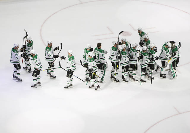 The Dallas Stars celebrate the win over the Calgary Flames after an NHL Western Conference Stanley Cup playoff hockey game, Thursday, Aug. 20, 2020, in Edmonton, Alberta. (Jason Franson/The Canadian Press via AP)