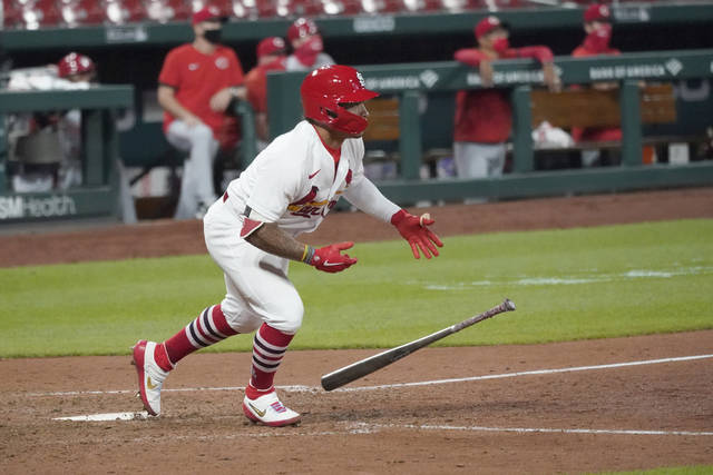 St. Louis Cardinals' Kolten Wong drops his bat after hitting a walk-off single to defeat the Cincinnati Reds in a baseball game Thursday, Aug. 20, 2020, in St. Louis. (AP Photo/Jeff Roberson)