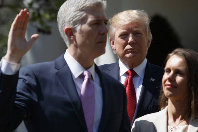 """FILE - In this April 10, 2017, file photo President Donald Trump watches as Supreme Court Justice Neil Gorsuch, accompanied by his wife Marie Louise, is sworn-in during a ceremony in the Rose Garden of the White House in Washington. """"I think the golden egg of Trump's reelection effort is going to be the promises kept, such as getting two Supreme Court Justices in power and keeping America out of foreign wars like Afghanistan and Iraq,"""" said Douglas Brinkley, presidential historian at Rice University. (AP Photo/Evan Vucci, File)"""